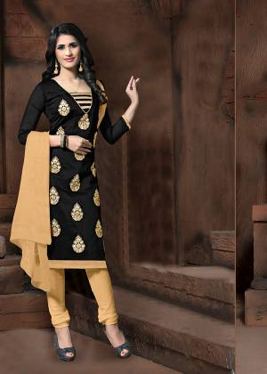 Simple Dress Material Is Here In Black Colored Top Paired With Cream Colored Bottom and Dupatta. Its Top Is Modal Silk Based Paired With Cotton Bottom And Chiffon Fabricated Dupatta. It Top Is Beautified With Thread Embroidery Work.