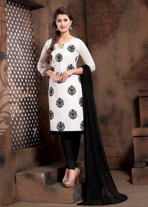 Add This Pretty Dress Material To Your Wardrobe In White Colored Top Paired With Black Colored Bottom And Dupatta. Its Top Is Modal Silk Based Paired With Cotton Bottom And Chiffon Fabricated Dupatta.