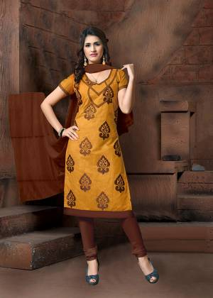 For Your Casual Or Semi-Casual Wear, Grab This Designer Straight Suit In Occur Yellow Color Paired With Contrasting Brown Colored Bottom And Dupatta. Its Top Is Fabricated On Modal Silk Paired With Cotton Bottom And Chiffon Fabricated Dupatta.