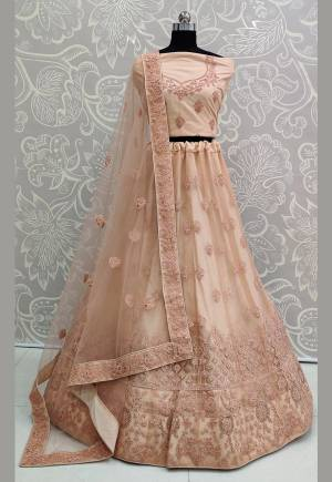 You Will Definitely Earn Lots Of Compliments Wearing This Designer Trendy Lehenga Choli In Peach Color. Its Blouse, Lehenga And Dupatta Are Fabricated On Net Beautified With Tone To Tone Embroidery Giving A Rich Subtle Look. Buy This Lovely Piece Now.