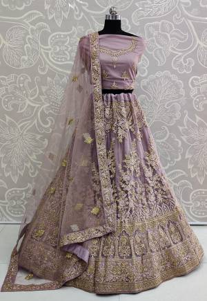 You Will Definitely Earn Lots Of Compliments Wearing This Designer Trendy Lehenga Choli In Mauve Color. Its Blouse, Lehenga And Dupatta Are Fabricated On Net Beautified With Tone To Tone Embroidery Giving A Rich Subtle Look. Buy This Lovely Piece Now.