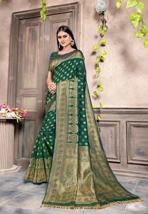 For A Proper Traditonal Look, Grab This Very Beautiful Designer Saree In Pine Green Color. This Saree Is Fabricated On Weaving Silk Paired With Art Silk Fabricated Blouse. Its Color and Rich Fabric Will Give An Attractive Look To Your Personality.