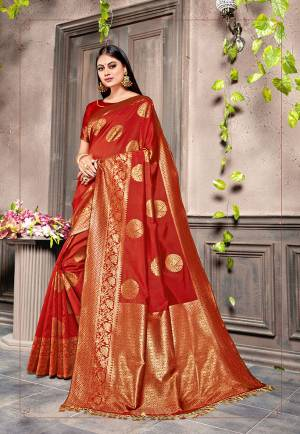 Look Attractive Wearing This Pretty Silk Based Saree In Red Color. This Saree and Blouse Are Silk Based Beautified With Heavy Weaving. Buy This Saree Now.