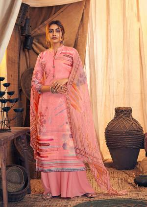 Get Ready For The Upcoming Winters Wearing This Designer Straight Suit In Pink Color. Its Pretty Top And bottom Are Fabricated On Wool Pashmina Paired With Chiffon Fabricated Dupatta. It Is Beautified with Prints And Stone Work.