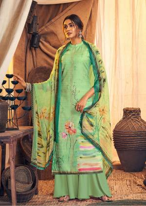 Get Ready For The Upcoming Winters Wearing This Designer Straight Suit In Light Green Color. Its Pretty Top And bottom Are Fabricated On Wool Pashmina Paired With Chiffon Fabricated Dupatta. It Is Beautified with Prints And Stone Work.