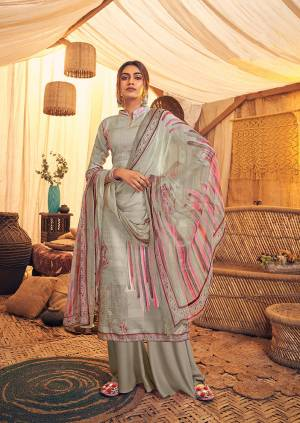 Here Is A Very Pretty And Trendy Straight suit In Grey Color. Its Top And Bottom Are Fabricated On Wool Pashmina Paired With Chiffon Based Dupatta, This Pretty Suit Is Suitable For The Upcoming Winters, Buy Now.