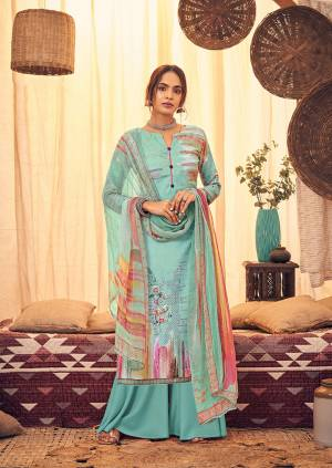 Here Is A Very Pretty And Trendy Straight suit In Sky Blue Color. Its Top And Bottom Are Fabricated On Wool Pashmina Paired With Chiffon Based Dupatta, This Pretty Suit Is Suitable For The Upcoming Winters, Buy Now.