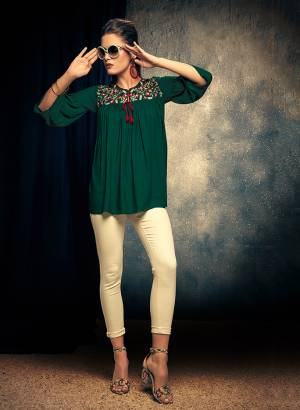 Here Is A Designer Readymade Top In Pine Green Color Fabricated On Rayon. This Pretty Top Is Beautified With Thread Work And Can Be Paired With Denim Or Pants.