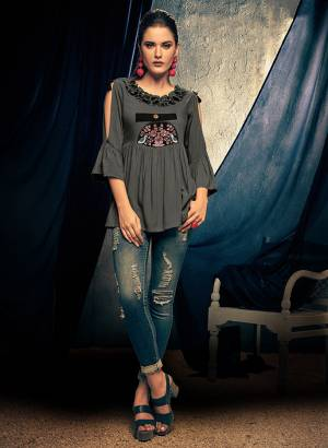 Here Is A Designer Readymade Top In Grey Color Fabricated On Rayon. This Pretty Top Is Beautified With Thread Work And Can Be Paired With Denim Or Pants.