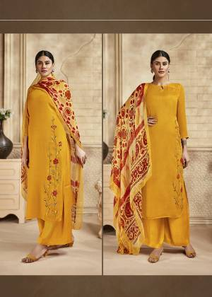 Here Is A Pretty Designer Straight Suit Suitable For The Upcoming Festive Season In This Lovely Yellow Color Paired With Red And Yellow Colored Dupatta. Its Top Is Fabricated On Saton Silk Beautified With Minimal Elegant Embroidery Paired With Santoon Bottom and Viscose Muslin Printed Dupatta. Buy this Pretty Suit Now.