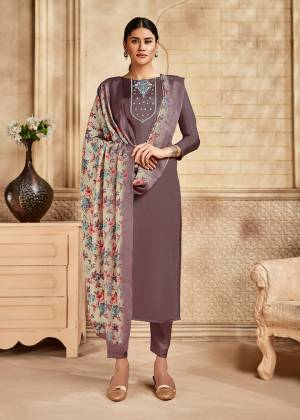 Here Is A Pretty Designer Straight Suit Suitable For The Upcoming Festive Season In This Lovely Mauve Color Paired With Multi Colored Dupatta. Its Top Is Fabricated On Saton Silk Beautified With Minimal Elegant Embroidery Paired With Santoon Bottom and Viscose Muslin Printed Dupatta. Buy this Pretty Suit Now.