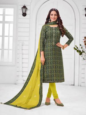 Grab This Designer Straight Suit For Your Semi-Casual Wear In Dark Green Color Paired With Parrot Green Colored Bottom and Dupatta. Its Top and Dupatta Are Chanderi Based Paired With Cotton Bottom.