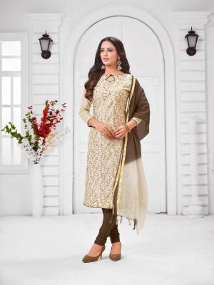 Simple And Elegant Looking Designer Straight Suit Is Here In Cream Color Paired With Brown Colored bottom And Dupatta. Its Top Is Fabricated On Modal Silk Paired With Cotton Bottom and Chanderi Cotton Dupatta.