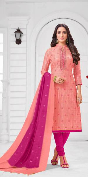Add This Pretty Suit To Your Wardrobe In Peach colored Top Paired With Contrasting Rani Pink Colored Bottom and Dupatta. Its Top Is Fabricated On Modal Silk Paired With Cotton Bottom and Dupatta.