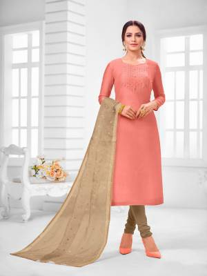 You Will Definitely Earn Lots Of Compliments Wearing This Designer Straight Suit In Peach Colored Top Paired With Beige Colored Bottom And Dupatta. Its Top Is Modal Silk Based Paired With Cotton Bottom and Orgenza Fabricated Dupatta.