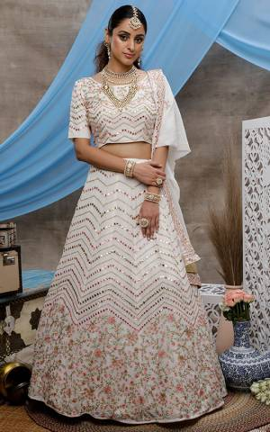 Here Is A Rich And Elegant Looking Designer Lehenga Choli In White Coolor. This Beautiful Detailed Embroidered Lehenga, Choli And Dupatta Are Fabricated On Georgette. Its Pretty Colors And Fabric Will Earn You Lots Of compliments From Onlookers.