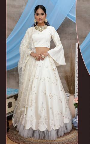 Grab This Designer Lehenga Choli For The Upcoming Wedding Season In White Color. Its Blouse And Lehenga Are Fabricated On Art Silk Paired With Net Fabricated Dupatta.