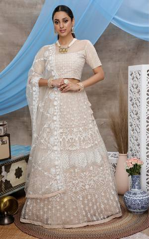 Look Pretty In This Lovely Designer Lehenga Choli In Cream Color. This Lehenga Choli Is Fabricated On Net Paired With Net Fabricated Dupatta. It Is Light In Weight and Easy To Carry Throughout The Gala.