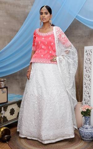 Grab This Designer Lehenga Choli For The Upcoming Wedding Season In Pink Colored Blouse Paired With White Colored Lehenga and Dupatta. Its Blouse Is Fabricated On Art Silk Paired With Net Fabricated Lehenga And Dupatta.