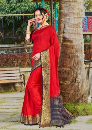 Celebrate This Festive Season With Beauty And Comfort Wearing This Pretty Saree In Red Color Paired With Navy Blue Colored Blouse. This Plain Saree Is Fabricated On Banarasi Silk With Broad Weaved Border Paired With Art Silk Fabricated Blouse.
