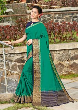 Simple And Elegant Looking Weaved Border Saree Is Here In Sea Green Color Paired With Navy Blue Colored Blouse. This Saree Is Fabricated On Banarasi Silk Paired With Art Silk Fabricated Blouse. Buy Now.
