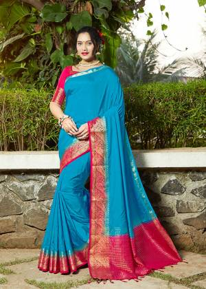 Celebrate This Festive Season With Beauty And Comfort Wearing This Pretty Saree In Blue Color Paired With Dark Pink Colored Blouse. This Plain Saree Is Fabricated On Banarasi Silk With Broad Weaved Border Paired With Art Silk Fabricated Blouse.