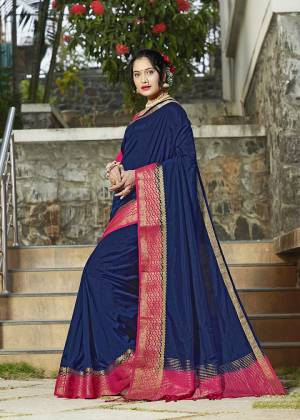 Celebrate This Festive Season With Beauty And Comfort Wearing This Pretty Saree In Navy Blue Color Paired With Dark Pink Colored Blouse. This Plain Saree Is Fabricated On Banarasi Silk With Broad Weaved Border Paired With Art Silk Fabricated Blouse.
