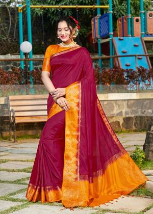 Simple And Elegant Looking Weaved Border Saree Is Here In Maroon Color Paired With Orange Colored Blouse. This Saree Is Fabricated On Banarasi Silk Paired With Art Silk Fabricated Blouse. Buy Now.