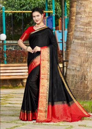 Celebrate This Festive Season With Beauty And Comfort Wearing This Pretty Saree In Black Color Paired With Red Colored Blouse. This Plain Saree Is Fabricated On Banarasi Silk With Broad Weaved Border Paired With Art Silk Fabricated Blouse.