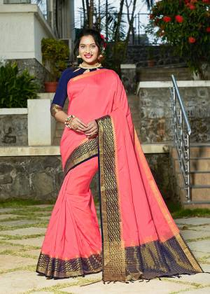 Celebrate This Festive Season With Beauty And Comfort Wearing This Pretty Saree In Pink Color Paired With Navy Blue Colored Blouse. This Plain Saree Is Fabricated On Banarasi Silk With Broad Weaved Border Paired With Art Silk Fabricated Blouse.