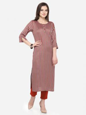 For Your Casual Wear, Grab This Pretty Readymade Straight Kurti In Maroon Color Fabricated On Rayon. This Kurti Can Be Paired With Same Or Contrasting Colored Pants, Leggings Or Plazzo.
