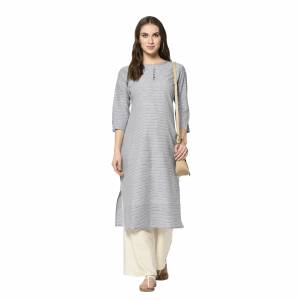 For Your Casual Wear, Grab This Pretty Readymade Straight Kurti In Grey Color Fabricated On Cotton. This Kurti Can Be Paired With Same Or Contrasting Colored Pants, Leggings Or Plazzo.