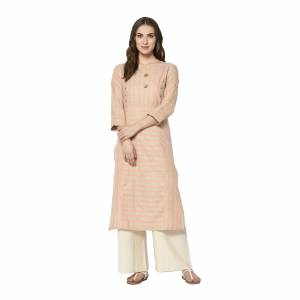 Add This Pretty Kurti To Your Wardrobe In Peach Color. This Readymade Kurti Is Fabricated On Cotton With Lining Prints. It Is Light In Weight And Easy To Carry All Day Long .