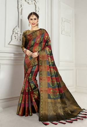 Look Attractive Wearing This Heavy Weaved silk Based Designer Saree In Maroon And Black Color. This Checks Patterned Saree Is Fabricated On Cotton Silk Paired With Art Silk Fabricated Blouse. Its Rich Fabric And Color Will Earn You Lots Of Compliments From Onlookers.