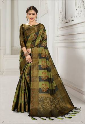 Look Attractive Wearing This Heavy Weaved silk Based Designer Saree In Green And Black Color. This Checks Patterned Saree Is Fabricated On Cotton Silk Paired With Art Silk Fabricated Blouse. Its Rich Fabric And Color Will Earn You Lots Of Compliments From Onlookers.