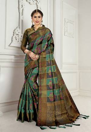 Look Attractive Wearing This Heavy Weaved silk Based Designer Saree In Sea Green And Black Color. This Checks Patterned Saree Is Fabricated On Cotton Silk Paired With Art Silk Fabricated Blouse. Its Rich Fabric And Color Will Earn You Lots Of Compliments From Onlookers.