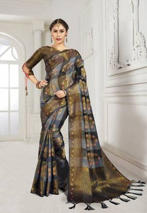 Look Attractive Wearing This Heavy Weaved silk Based Designer Saree In Grey And Black Color. This Checks Patterned Saree Is Fabricated On Cotton Silk Paired With Art Silk Fabricated Blouse. Its Rich Fabric And Color Will Earn You Lots Of Compliments From Onlookers.