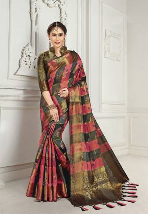 Look Attractive Wearing This Heavy Weaved silk Based Designer Saree In Pink And Black Color. This Checks Patterned Saree Is Fabricated On Cotton Silk Paired With Art Silk Fabricated Blouse. Its Rich Fabric And Color Will Earn You Lots Of Compliments From Onlookers.