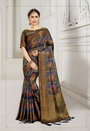 Look Attractive Wearing This Heavy Weaved silk Based Designer Saree In Blue And Black Color. This Checks Patterned Saree Is Fabricated On Cotton Silk Paired With Art Silk Fabricated Blouse. Its Rich Fabric And Color Will Earn You Lots Of Compliments From Onlookers.