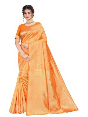 Here Is An Attractive Looking Heavy Weaved Designer Saree In Orange Color. This Saree and Blouse Are Fabricated On Art Silk Beautified With Detailed Weave. Buy Now.