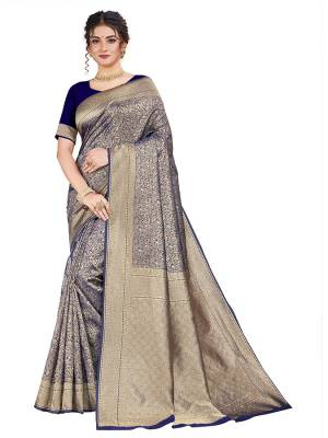 Here Is An Attractive Looking Heavy Weaved Designer Saree In Navy Blue Color. This Saree and Blouse Are Fabricated On Art Silk Beautified With Detailed Weave. Buy Now.