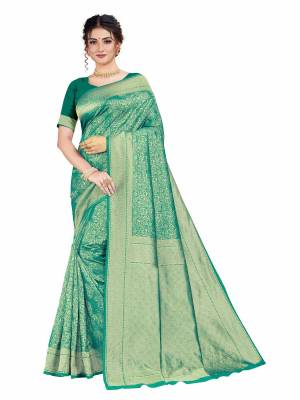 Celebrate This Festive Season With Beauty And Comfort Wearing This Designer Silk Based Saree In Green Color. This Saree And Blouse Are Fabricated on Art Silk Beautified With Heavy Weave.