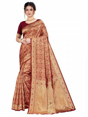 Celebrate This Festive Season With Beauty And Comfort Wearing This Designer Silk Based Saree In Maroon Color. This Saree And Blouse Are Fabricated on Art Silk Beautified With Heavy Weave.