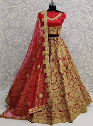Here Is A Beautiful Heavy Embroidered Bridal Lehenga Choli In Red Color. Its Heavy Embroidered Blouse and Lehenga Are Fabricated On Art Silk Paired With Net Fabricated Dupatta.
