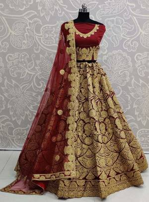 Here Is A Beautiful Heavy Embroidered Bridal Lehenga Choli In Maroon Color. Its Heavy Embroidered Blouse and Lehenga Are Fabricated On Art Silk Paired With Net Fabricated Dupatta.