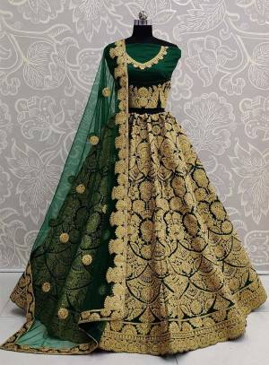 Here Is A Beautiful Heavy Embroidered Bridal Lehenga Choli In Dark Green Color. Its Heavy Embroidered Blouse and Lehenga Are Fabricated On Art Silk Paired With Net Fabricated Dupatta.