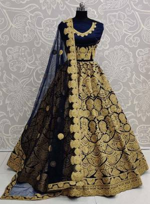 Here Is A Beautiful Heavy Embroidered Bridal Lehenga Choli In Navy Blue Color. Its Heavy Embroidered Blouse and Lehenga Are Fabricated On Art Silk Paired With Net Fabricated Dupatta.