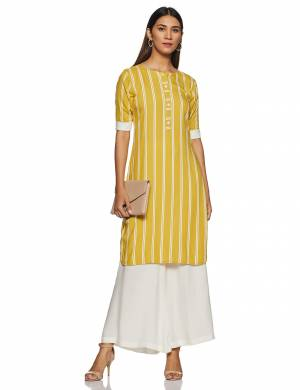 Here Is A Very Pretty And Elegant Looking Kurti In Yellow Color Paired With White Colored bottom. Its Fabric Is Soft Towards Skin And Ensures Superb Comfort All Day Long.
