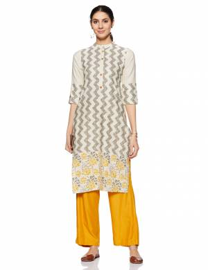Here Is A Very Pretty And Elegant Looking Kurti In Light Grey Color. Its Fabric Is Soft Towards Skin And Ensures Superb Comfort All Day Long.