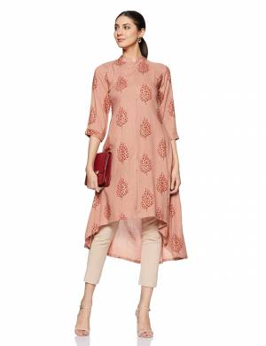 Be It Your College, Home Or Work Place, This Pretty Readymade Kurti Is Suitable For All. Its Elegant Peach Color And Light Weight Fabric Gives Rich Look To Your Personality. Buy Now.